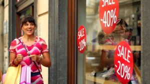 stock-footage-woman-looking-at-shop-window-with-sales-promotion