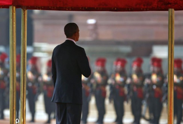 U.S. President Obama inspects guard of honour during his ceremonial reception at the forecourt of India's presidential palace Rashtrapati Bhavan in New Delhi