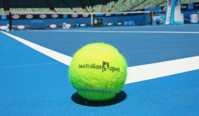 hi-res-460656969-an-australian-open-tennis-ball-rests-on-the-court-of_crop_exact