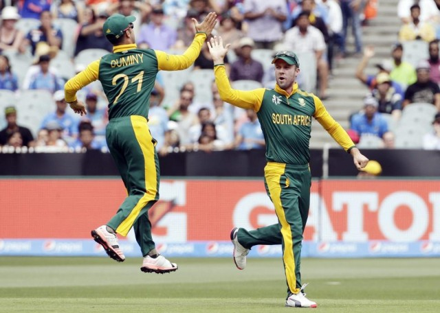 South Africa's de Villiers celebrates with Duminy, after he ran out India's Sharma for a duck, during their Cricket World Cup match at the MCG