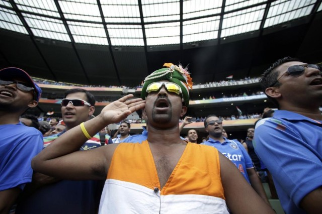 Indian supporters sing their national anthem before the start of the Cricket World Cup match between India and South Africa at the MCG