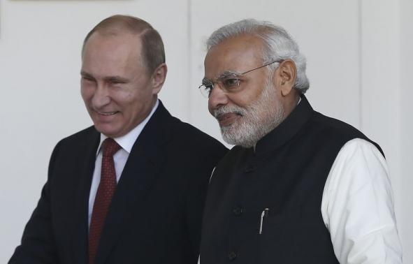 Russian President Putin and India's Prime Minister Modi arrives for a photo opportunity ahead of their meeting at Hyderabad House in New Delhi