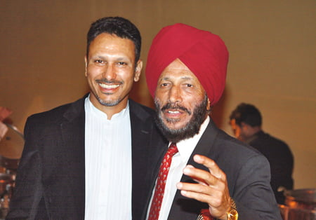 NEW DELHI, INDIA - FEBRUARY 27:  Jeev Milkha Singh of India with his father Milkha Singh the Indian Commonwealth Games Gold Medallist runner during the dinner the pro-am for the 2008 Johnnie Walker Classic held at The DLF Golf and Country Club on February 27, 2008 in New Delhi, India.  (Photo by David Cannon/Getty Images)