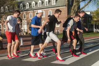 Male students of Stanford  University pictured here, walking in women's heeled shoes for a campaign against sexual violence.