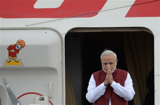 CORRECTS NAME AND TITLE - Indian Prime Minister, Narenda Modi, gestures upon arrival in Ufa, Russia, Wednesday, July 8, 2015. Ufa hosts SOC (Shanghai Cooperation Organization) and BRICS (Brazil, Russia, India, China and South Africa) summits. (Host photo agency/RIA Novosti Pool Photo via AP)