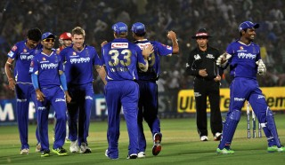 Rajasthan Royals players celebrate fall of wicket during the match between Kings XI Punjab and Rajasthan Royals at Jaipur stadium on April 14, 2013. (Photo: IANS)