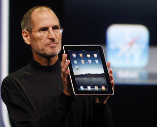 Apple CEO Steve Jobs shows off the new iPad during an event in San Francisco, Wednesday, Jan. 27, 2010. (AP Photo/San Francisco Chronicle, Paul Chinn) MANDATORY CREDIT