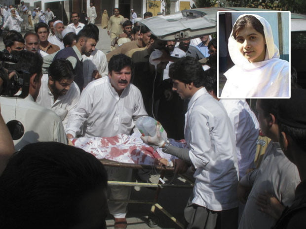 Hospital staff assist Malala Yousufzai, a 14-year-old schoolgirl who was wounded in a gun attack, at Saidu Sharif Teaching Hospital in the Swat Valley region in northwest Pakistan October 9, 2012. According to authorities, gunmen in Pakistan shot and seriously wounded Yousufzai on Tuesday for speaking out against Taliban militants. Yousufzai became famous for speaking out against the Pakistani Taliban at a time when even the government seemed to be appeasing the hardline Islamists. REUTERS/Hazart Ali Bacha  (PAKISTAN - Tags: POLITICS CIVIL UNREST CRIME LAW)