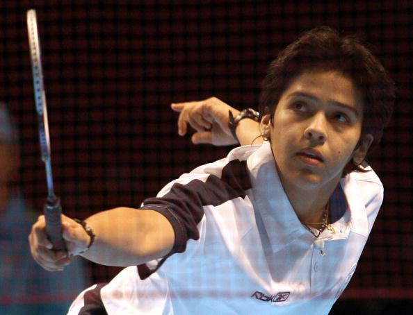Melbourne, AUSTRALIA:  Indian badminton player Saina Nehwal hits a return during her women's singles match against Cynthia Denise Course of Seychelles in the mixed team preliminary round at the Commonwealth Games in Melbourne, 17 March 2006. Nehwal defeated Course 21-3, 21-4.  AFP PHOTO/TORU YAMANAKA  (Photo credit should read TORU YAMANAKA/AFP/Getty Images)