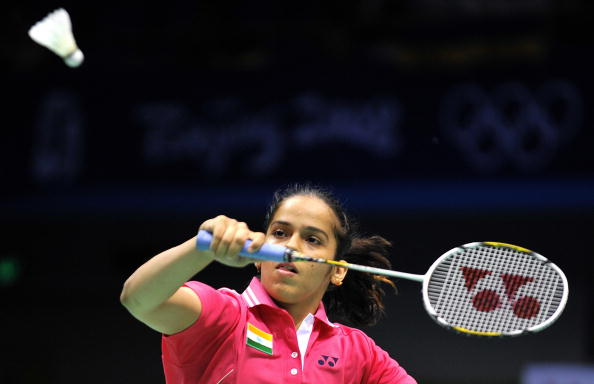 India's Saina Nehwal eyes the shuttlecock during her women's singles third round badminton match against Hong Kong's Wang Chen (not pictured) during the 2008 Beijing Olympic Games at the Beijing University of Technology Gymnasium on August 11, 2008. Nehwal won 21-19, 11-21, 21-11. AFP PHOTO/FABRICE COFFRINI (Photo credit should read FABRICE COFFRINI/AFP/Getty Images)