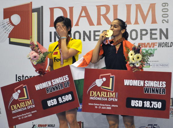India's Saina Nehwal (R) and China's Lin Wang show their medals after the women's singles final at the Indonesian Open 2009 badminton competition in Jakarta on June 21, 2009.  India won 12-21, 21-18, 21-9. AFP PHOTO/Bay ISMOYO (Photo credit should read BAY ISMOYO/AFP/Getty Images)