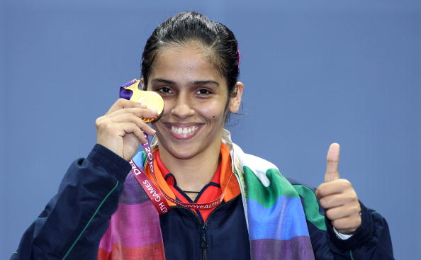 DELHI, INDIA - OCTOBER 14:  Saina Nehwal of India celebrates winning a gold medal in the women's singles badminton at Vijay Chowk during day eleven of the Delhi 2010 Commonwealth Games on October 14, 2010 in Delhi, India.  (Photo by Ian Walton/Getty Images)