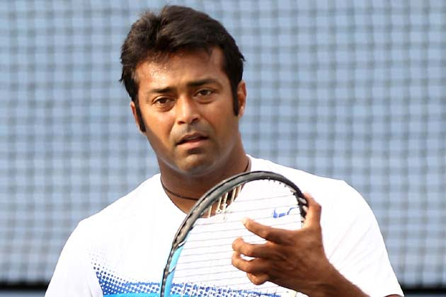 MASON, OH - AUGUST 18:  The doubles team of Mahesh Bhupathi and Leander Paes of India talk in between games of their match against Marc Lopez and Rafael Nadal of Spain during the Western & Southern Open at the Lindner Family Tennis Center on August 18, 2011 in Mason, Ohio.  (Photo by Elsa/Getty Images)