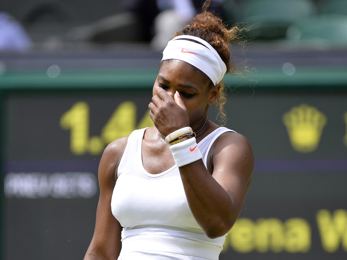 Serena Williams of the U.S. reacts during her women's singles tennis match against Sabine Lisicki of Germany at the Wimbledon Tennis Championships, in London July 1, 2013.          REUTERS/Toby Melville (BRITAIN  - Tags: SPORT TENNIS)   - RTX118OQ