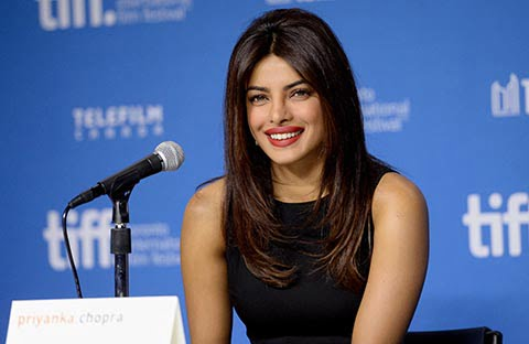 "TORONTO, ON - SEPTEMBER 04:  Actress Priyanka Chopra speaks onstage at the ""Mary Kom"" Press Conference during the 2014 Toronto International Film Festival at TIFF Bell Lightbox on September 4, 2014 in Toronto, Canada.  (Photo by Jason Merritt/Getty Images) ORG XMIT: 509673759"