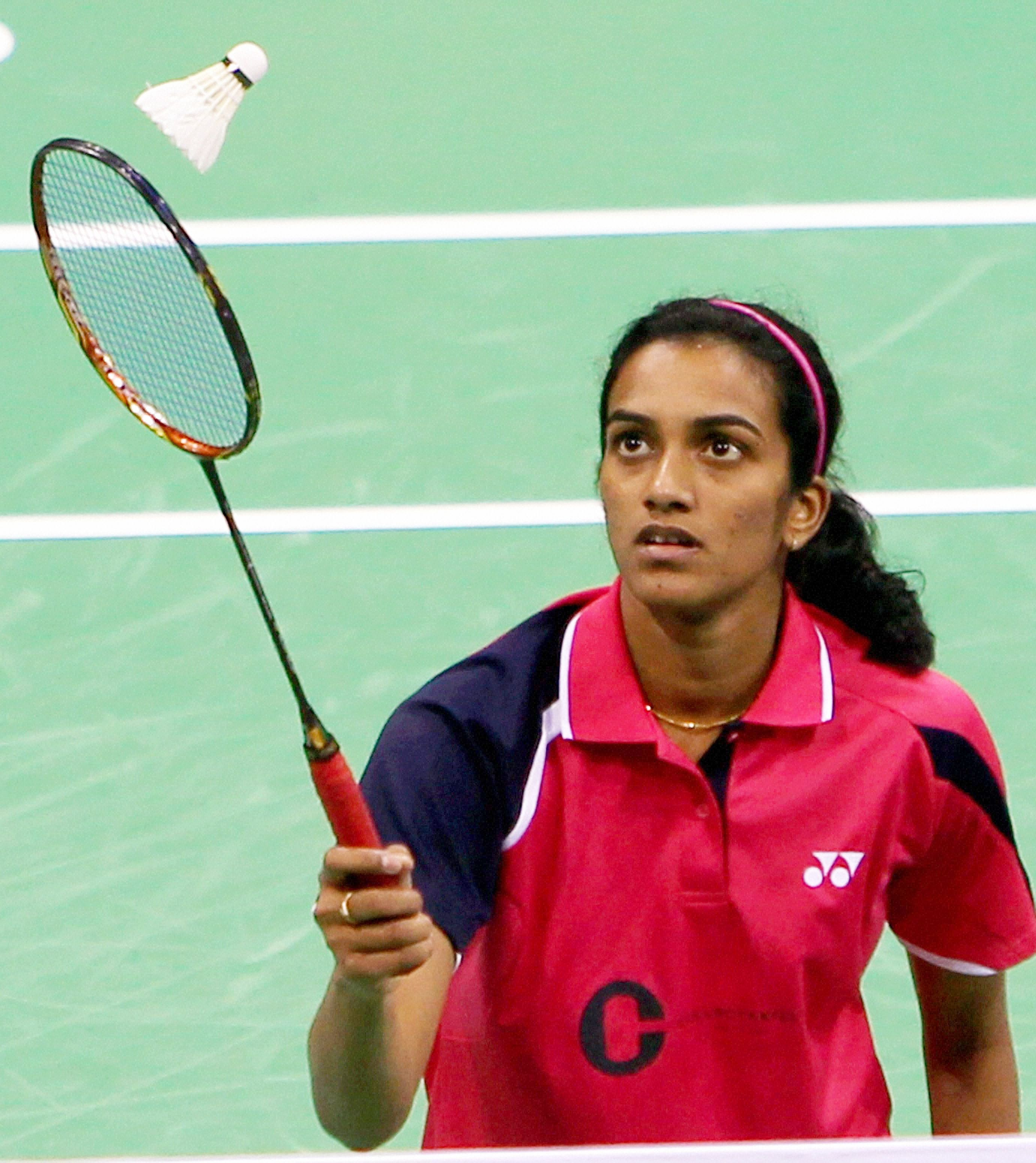 New Delhi: India's P V Sindhu returns shuttlecock to  Chinese Yao Xue during their match at Yonex Sunrise India Open 2013, in New Delhi on Wednesday. PTI Photo by Manvender Vashist(PTI4_24_2013_000214B)