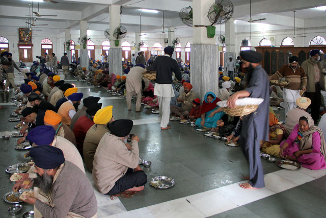 - Excellent quality food is served for the Langar. The concept of `Langar' (a free communal meal) is a very old tradition an important institution for the Sikhs which was started by the first Sikh Guru, Guru Nanak. It was designed to uphold the principle of equality between all people regardless of religion, caste, colour, creed, age, gender or social status, a revolutionary concept in the caste-ordered society of 16th century India where Sikhism began. In addition to the ideals of equality, the tradition of Langar expresses the ethics of sharing, community, inclusiveness and oneness of all humankind. In the Golden Temple Complex the huge Langar building is a three storied structure with exposed brick work. The ground and the first floor are used for the Langar, which feeds about 40.000 Pilgrims throughout the day. All the preparation, the cooking and the washing-up is also done by voluntary helpers, known as Sewadars, even Sikh children help in serving food to the people (Sangat). The Langar is financed by donations. Donation boxes can be found on different places of the complex.
