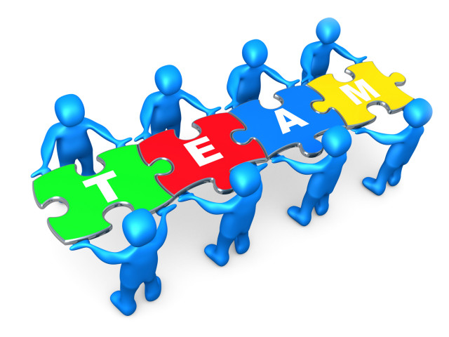 """Royalty-free 3d computer generated clipart picture image of a team of 8 blue people holding up connected pieces to a colorful puzzle that spells out """"team,"""" symbolizing excellent teamwork, success and link exchanging."""