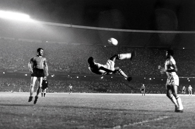 Sport, Football, Friendly International, Maracana Stadium, Rio de Janeiro, 2nd June 1965, Brazil 5 v Belgium 0, Brazil's Pele makes an attempt on goal with an athletic overhead kick, Pele was perhaps the most famous footballer of all time and featured in 4 World Cups,forced out of the finals in Chile in 1962 and England in 1966 through injury he won 2 World Cup winners medals with Brazil playing in the successful teams of 1958 in Sweden, at the age of 17, and the famous 1970 team which won the World Cup in Mexico (Photo by Popperfoto/Getty Images)