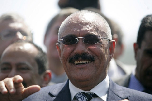 Yemeni President Ali Abdullah Saleh looks on after inaugurating the liquefied natural gas (LNG) plant in the southeastern port of Balhaf November 7, 2009. Yemen dispatched its first liquefied natural gas (LNG) shipment on Saturday from a $4.5 billion Total-led plant, as the leader of the violence-torn country sought to soothe security concerns. The first shipment left the export terminal at Belhaf for South Korea aboard a Korean tanker, carrying around 149,000 cubic metres of LNG. REUTERS/Khaled Abdullah (YEMEN POLITICS CONFLICT ENERGY BUSINESS)