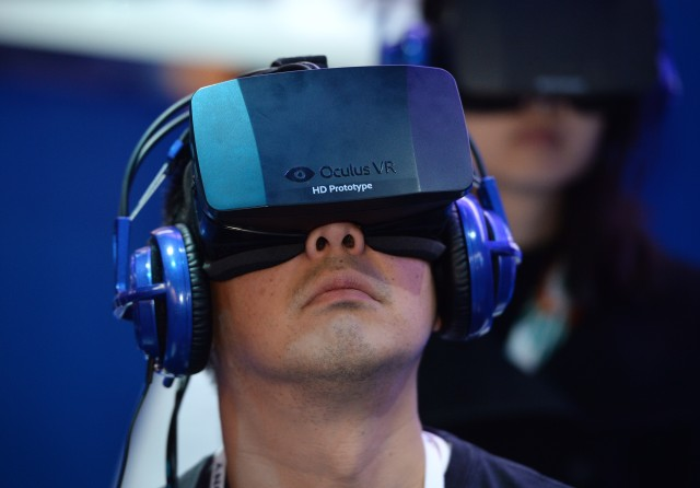 FILE - MARCH 25, 2014: According to reports, Facebook will acquire virtual realty tech company Oculus Rift for $2 billion. An attendee wears an Oculus Rift HD virtual reality head-mounted display at he plays EVE: Valkyrie, a multiplayer virtual reality dogfighting shooter game, at the Intel booth at the 2014 International CES, January 9, 2014 in Las Vegas, Nevada. AFP PHOTO /ROBYN BECK (Photo credit should read ROBYN BECK/AFP/Getty Images) ORG XMIT: 461322677 ORIG FILE ID: 461621859
