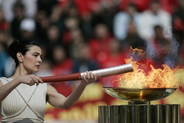 The Olympic flame is lit by Greek actress Maria Nafpliotou during the handover ceremony of the Beijing 2008 Olympic flame at the Panathenian stadium site of the first modern Olympic games in 1896 March 30, 2008. REUTERS/John Kolesidis (GREECE)