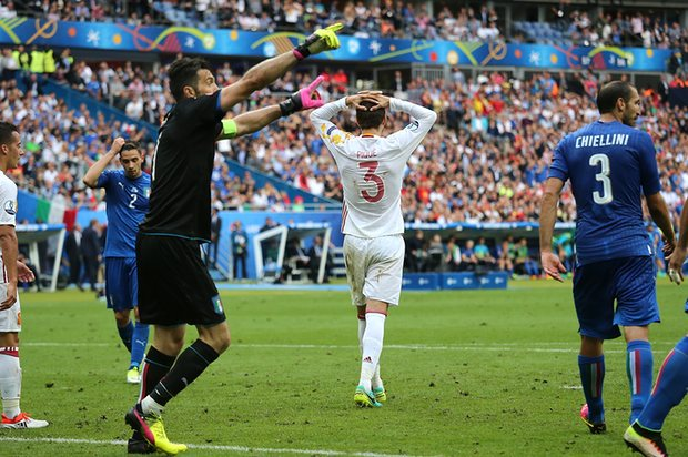 Buffon saves Pique's volley to keep Spain out of reach.