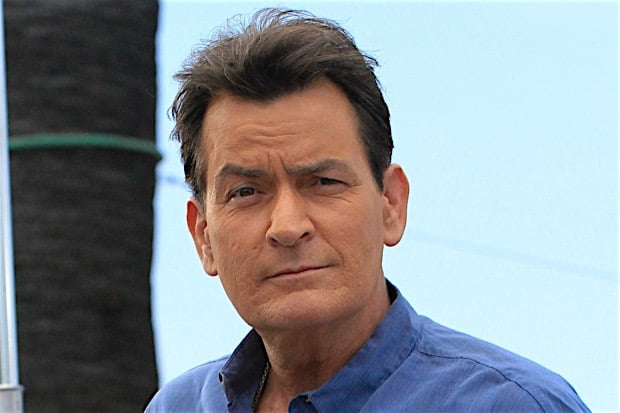 **USA ONLY** Universal City, CA - Charlie Sheen checks his zipper as he arrives for an interview on the 'Extra' stage at Universal Studios in Universal City. Charlie smiled for the fans and cameras as he made his way to the stage with his staff close behind. AKM-GSI May 12, 2015 **USA ONLY** To License These Photos, Please Contact : Steve Ginsburg (310) 505-8447 (323) 423-9397 steve@akmgsi.com sales@akmgsi.com or Maria Buda (917) 242-1505 mbuda@akmgsi.com ginsburgspalyinc@gmail.com