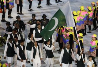 Ghulam Mustafa Bashir carries the flag of Pakistan during the opening ceremony for the 2016 Summer Olympics in Rio de Janeiro, Brazil, Friday, Aug. 5, 2016. (AP Photo/Patrick Semansky)