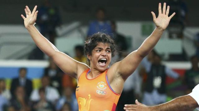 2016 Rio Olympics - Wrestling - Final - Women's Freestyle 58 kg Bronze - Carioca Arena 2 - Rio de Janeiro, Brazil - 17/08/2016. Sakshi Malik (IND) of India celebrates winning the bronze medal after her victory against Aisuluu Tynybekova (KGZ) of Kyrgyzstan. REUTERS/Ruben Sprich FOR EDITORIAL USE ONLY. NOT FOR SALE FOR MARKETING OR ADVERTISING CAMPAIGNS.