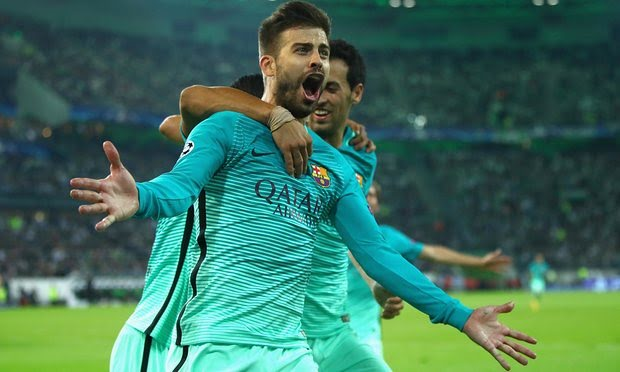Gerard Pique celebrates after scoring.