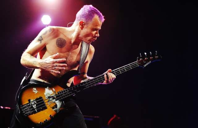 "RESTRICTED TO EDITORIAL USE - NO MARKETING NO ADVERTISING CAMPAIGNS US bassist of the American rock band Red Hot Chili Peppers, Michael ""Flea"" Balzary, performs during a concert at the Globe in Stockholm on October 12, 2011. AFP PHOTO / JONATHAN NACKSTRAND (Photo credit should read JONATHAN NACKSTRAND/AFP/Getty Images)"