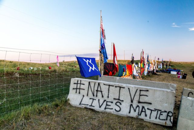 flags-from-many-nations-line-the-fence-outside-the-dig-site-native-lives-matter-_8-16_alex-hamer-photo