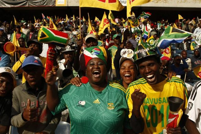 South Africa's soccer fans cheer during their team's international friendly soccer match.