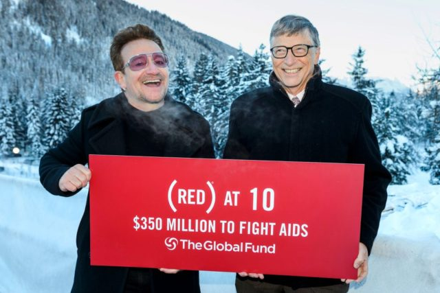 Singer of Irish band U2, Bono (L) poses with Bill Gates at the World Economic Forum annual meeting on January 22, 2016 in Davos to mark the 10 years of (RED).