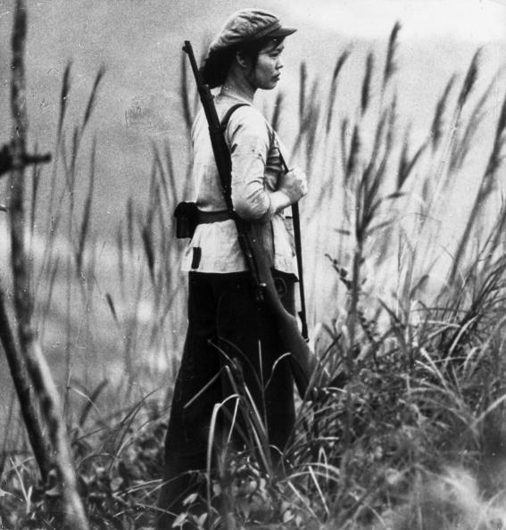 North Vietnamese soldier, Nguen Thi-Hai, standing guard. (Photo by Keystone/Getty Images)