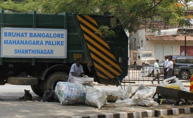 Bengaluru scam: A BBMP truck collecting garbage in the street