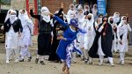 women stone pelting in kashmir