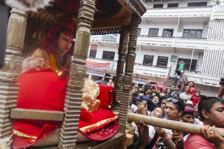 Outgoing Kumari, Matina Shakya, being carried back home