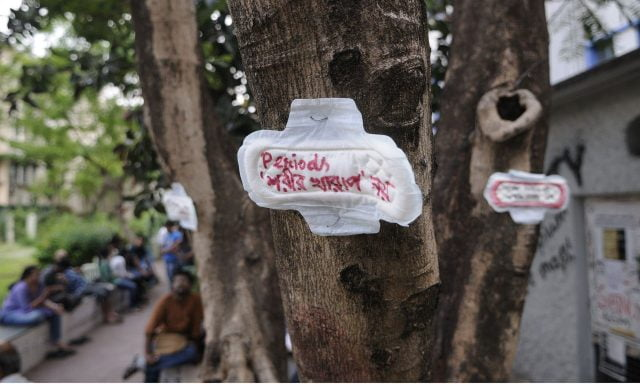 """A sanitary pad protest against breaking menstrual taboos. The message reads """"Periods is not an illness"""""""