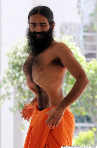 In this file photograph taken on June 7, 2011 Indian spiritual guru Swami Baba Ramdev performs yoga during his hunger strike at the Pitanjali Yogpeeth in Haridwar, some 240kms from New Delhi.  A popular Indian yoga guru whose protest against corruption was crushed by police at the weekend warned on June 8, 2011 of violence and threatened to train an army of 11,000 followers. Swami Ramdev, also known as Baba Ramdev, issued the call-to-arms from his ashram near the holy town of Haridwar 130 miles (200 kilometres) north of New Delhi after he was ejected from the capital.  AFP PHOTO/ Manan VATSYAYANA/FILES (Photo credit should read MANAN VATSYAYANA/AFP/Getty Images)