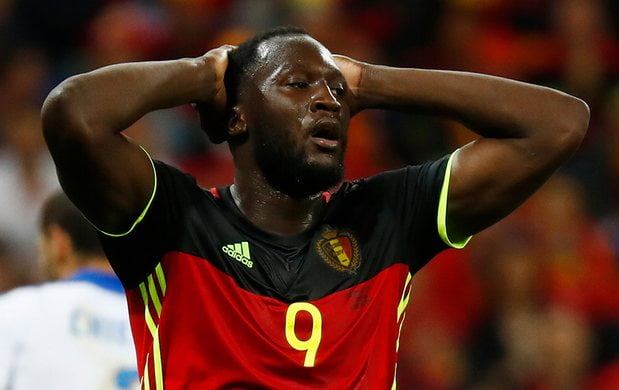 Lukaku reacts after missing his chance at goal