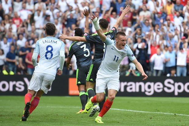 Jamie Vardy races away to celebrate the equalizer as Welsh players appeal for offside