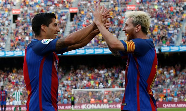 Suarez and Messi celebrate as Barcelona rout Real Betis, with the duo combining for 5 goals.