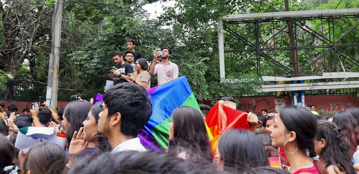 hansraj pride parade with a few people standing above everyone on a car