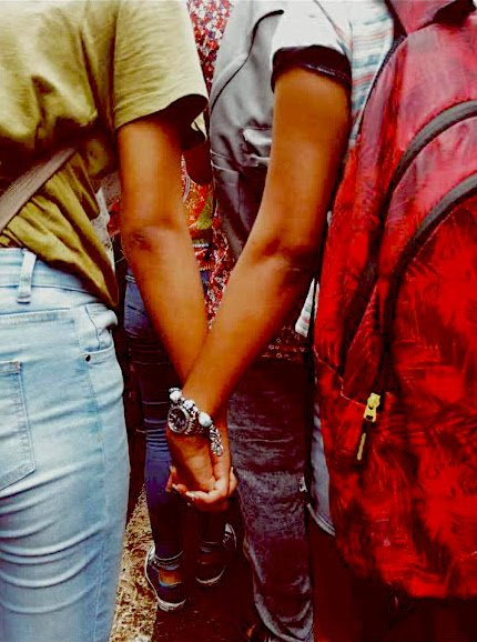 two women holding hands at hansraj pride parade